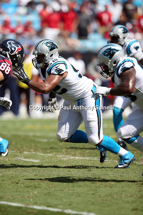 Carolina Panthers defensive tackle Dwan Edwards (92) chases the action during the 2015 NFL week 2 regular season football game against the Houston Texans on Sunday, Sept. 20, 2015 in Charlotte, N.C. The Panthers won the game 24-17. (©Paul Anthony Spinelli)