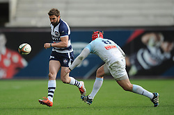 Bristol Rugby replacement Craig Hampson kicks the ball down the line under pressure from Bedford Blues Number 8 Nick Fenton-Wells (capt) - Photo mandatory by-line: Dougie Allward/JMP - Mobile: 07966 386802 - 29/03/2015 - SPORT - Rugby - Bristol - Ashton Gate - Bristol Rugby v Bedford Blues - Greene King IPA Championship