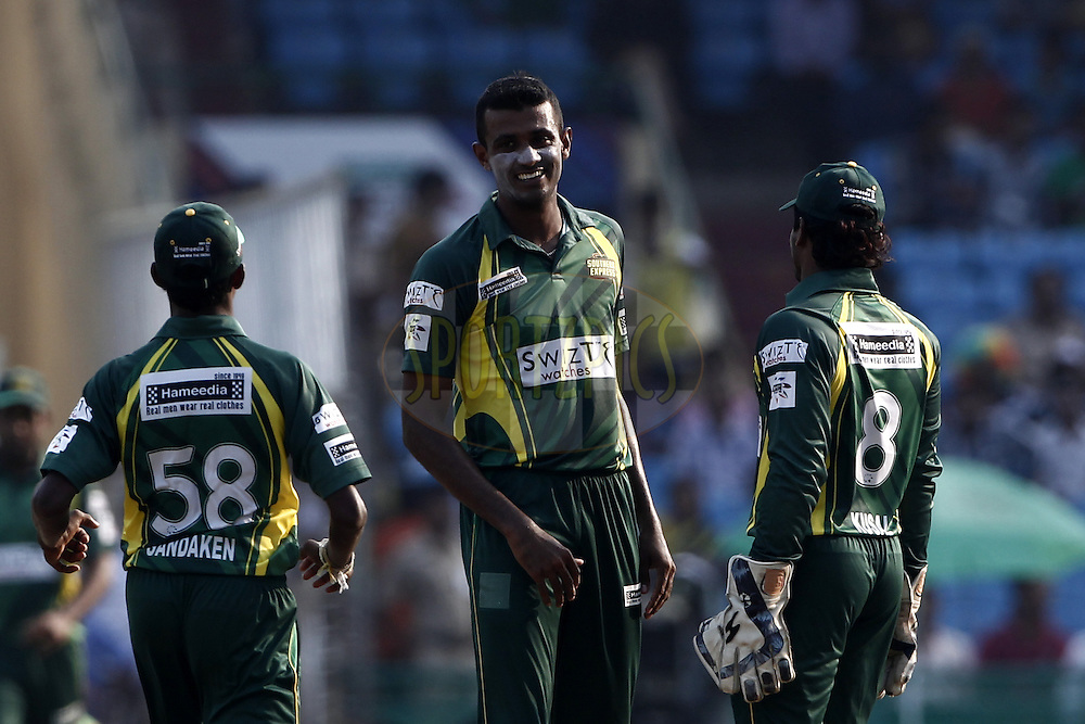 Farveez Maharoof of the SOUTHERN EXPRESS  celebrates the wicket of  Umar Siddique of the LAHORE LIONS during the qualifier 5 match of the Oppo Champions League Twenty20 between the Southern Express and the Lahore Lions held at the Chhattisgarh International Cricket Stadium, Raipur, India on the 16th September 2014<br /> <br /> Photo by:  Deepak Malik / Sportzpics/ CLT20<br /> <br /> <br /> Image use is subject to the terms and conditions as laid out by the BCCI/ CLT20.  The terms and conditions can be downloaded here:<br /> <br /> http://sportzpics.photoshelter.com/gallery/CLT20-Image-Terms-and-Conditions-2014/G0000IfNJn535VPU/C0000QhhKadWcjYs