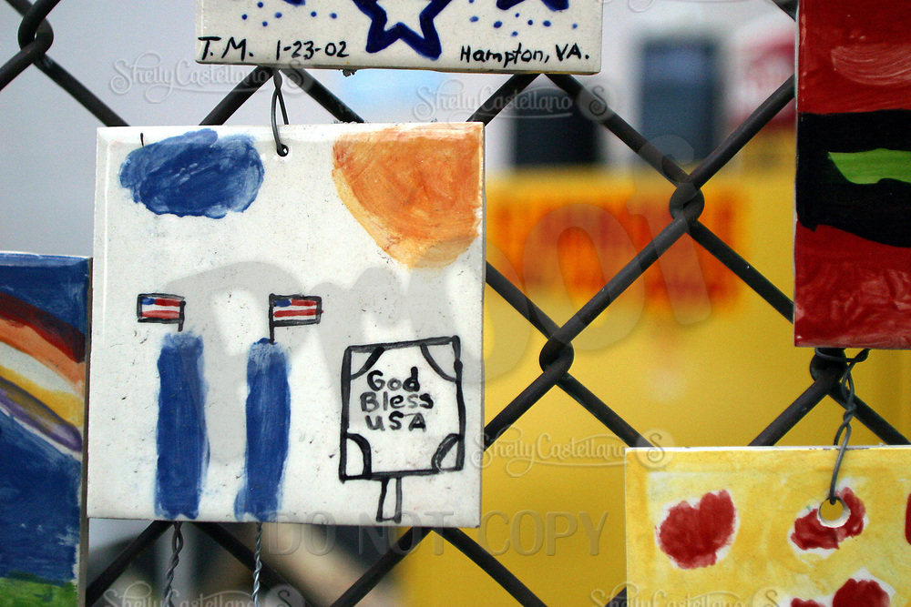 Aug 16, 2002; New York, NY, USA; Hand painted color tiles from vistors hang on fencing across from St. Vincents Hospital in Greenwich Village in Midtown Manhattan.  Mandatory Credit: Photo by Shelly Castellano/ZUMA Press. (©) Copyright 2002 by Shelly Castellano