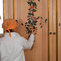 An artisan paints a  detailed design in one of the newly refurbished suites of Gritti Hotel..Several major restoration works are being carried out in this period in Venice, the go to a complete refurbishment of the famous Gritti Palace Hotel, to transformation into a luxury VIP 7 stars hotel of XV century Palazzo Papadopoli to the restoration of the Church of the Gesuiti