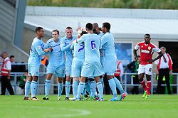 Coventry City's Callum Wilson celebrates with his team mates after scoring. - Photo mandatory by-line: Dougie Allward/JMP - Tel: Mobile: 07966 386802 11/08/2013 - SPORT - FOOTBALL - Sixfields Stadium - Sixfields Stadium -  Coventry V Bristol City - Sky Bet League One