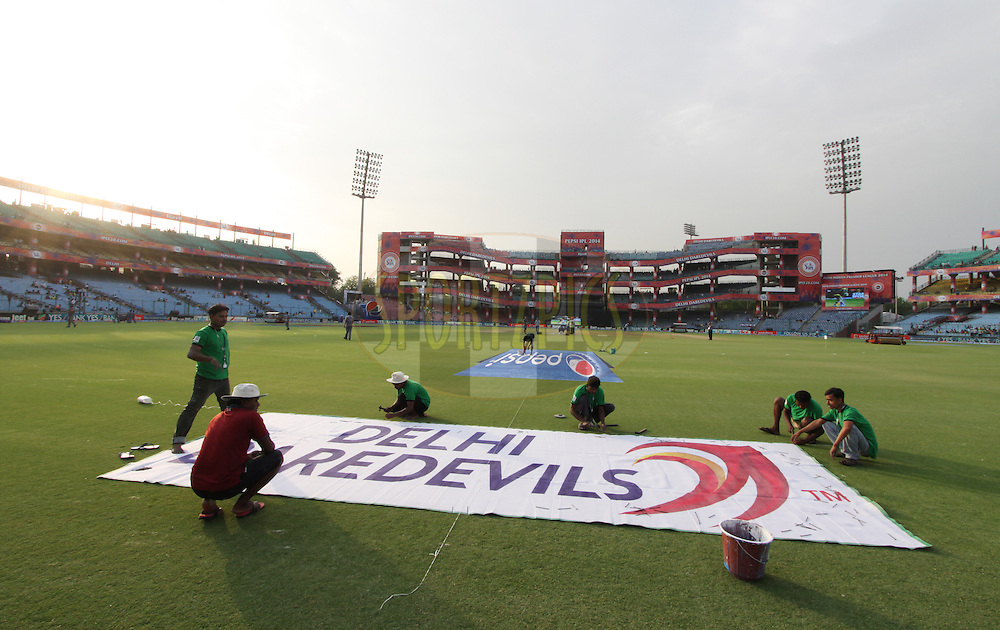 Ground staff fix brading on ground during match 26 of the Pepsi Indian Premier League Season 2014 between the Delhi Daredevils and the Chennai Superkings held at the Ferozeshah Kotla cricket stadium, Delhi, India on the 5th May  2014<br /> <br /> Photo by Arjun Panwar / IPL / SPORTZPICS<br /> <br /> <br /> <br /> Image use subject to terms and conditions which can be found here:  http://sportzpics.photoshelter.com/gallery/Pepsi-IPL-Image-terms-and-conditions/G00004VW1IVJ.gB0/C0000TScjhBM6ikg