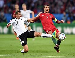 Florian Klein of Austria tackles Cristiano Ronaldo of Portugal  - Mandatory by-line: Joe Meredith/JMP - 18/06/2016 - FOOTBALL - Parc des Princes - Paris, France - Portugal v Austria - UEFA European Championship Group F