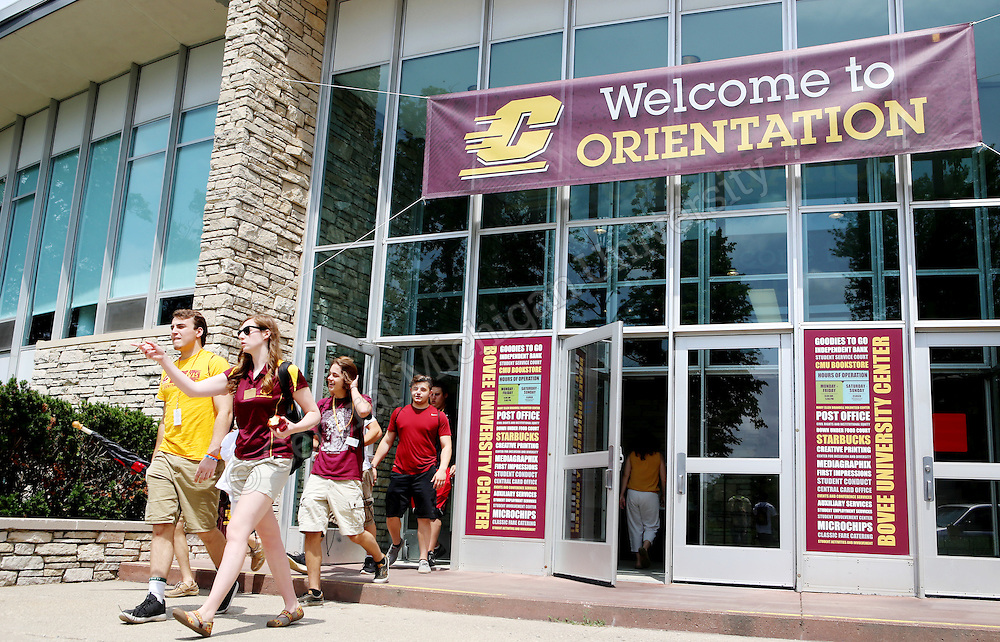 A group of incoming Freshman walk out of the Bovee University Center during Freshman Orientation photo by Emily Mesner