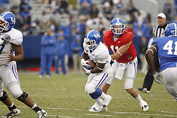 Quarterback Maxwell Smith, right, hands off to running back Raymond Sanders. UK Blue/White Football game 2012, Saturday, April 21, 2012 at the Commonwealth Stadium in Lexington.