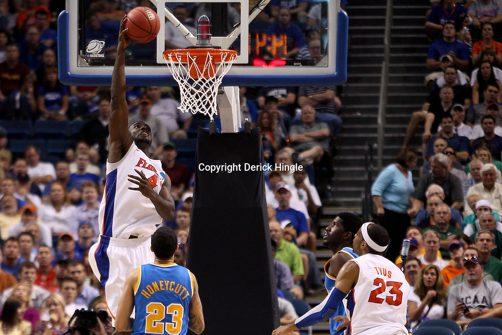 Mar 19, 2011; Tampa, FL, USA; Florida Gators forward/center Patric Young (4) dunks over UCLA Bruins forward Tyler Honeycutt (23) during second half of the third round of the 2011 NCAA men's basketball tournament at the St. Pete Times Forum. Florida defeated UCLA 73-65.  Mandatory Credit: Derick E. Hingle