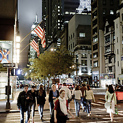 People walking on the street by night in fifth avenue