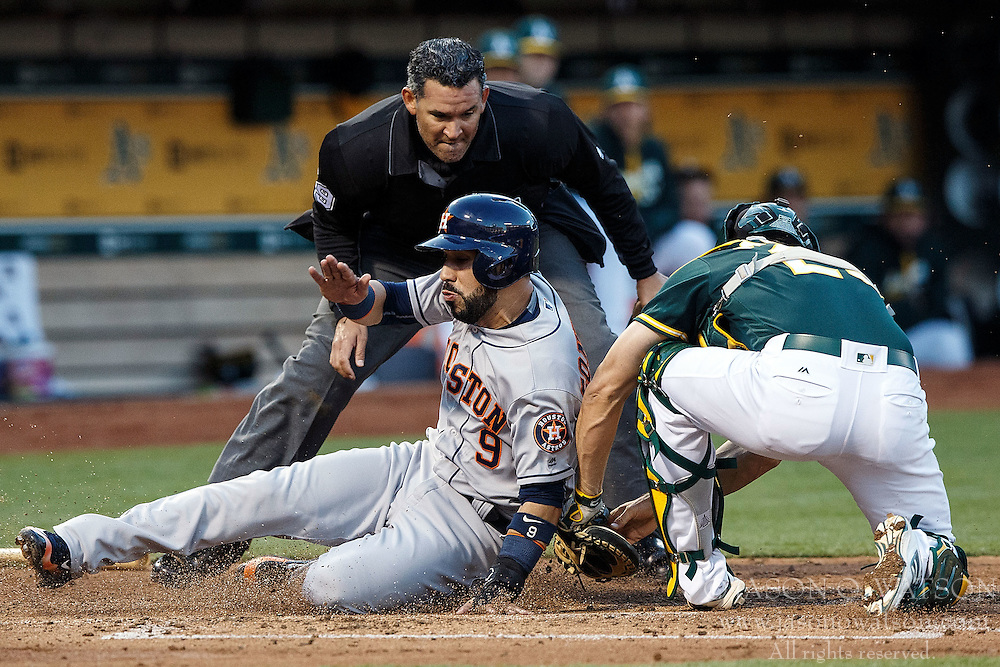 OAKLAND, CA - JULY 19:  Marwin Gonzalez #9 of the Houston Astros is tagged out at home plate by Matt McBride #29 of the Oakland Athletics in front of umpire Manny Gonzalez #79 during the third inning at the Oakland Coliseum on July 19, 2016 in Oakland, California. (Photo by Jason O. Watson/Getty Images) *** Local Caption *** Marwin Gonzalez; Matt McBride; Manny Gonzalez
