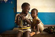 Children sit outside the Kaniya PHU in the village of Kaniya, Sierra Leone, on Friday April 23, 2010..