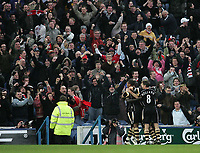 Photo: Lee Earle.<br /> Portsmouth v Charlton Athletic. The Barclays Premiership. 20/01/2007.Charlton's Amdy Faye is congratulated in front of the happy away supporters after scoring the winning goal.