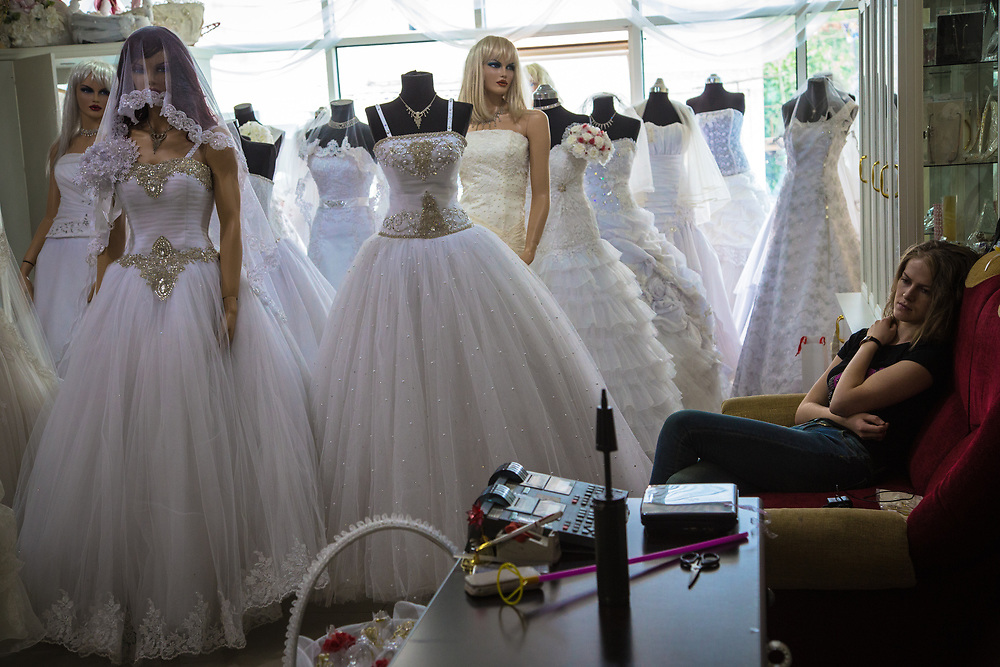 The Stepanakert Mall, formerly a trade center, was inaugurated in 2009 financed by foreign funds. Currently, most of its stores are empty. In the mall's second floor there is a bridal shop. The store employee works 7 days a week for 120 euros per month and sees very few customers.     © Daniel Barreto Mezzano