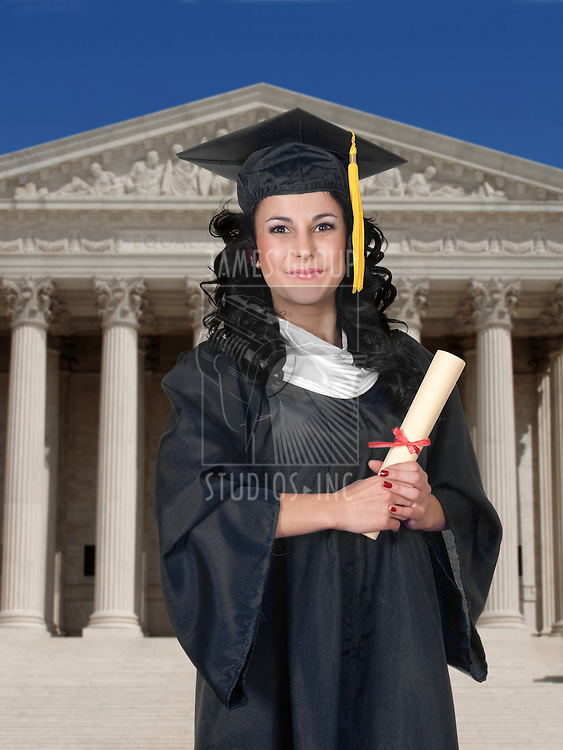Young woman in cap and gown holding a diploma with classic Greek architecture in the background