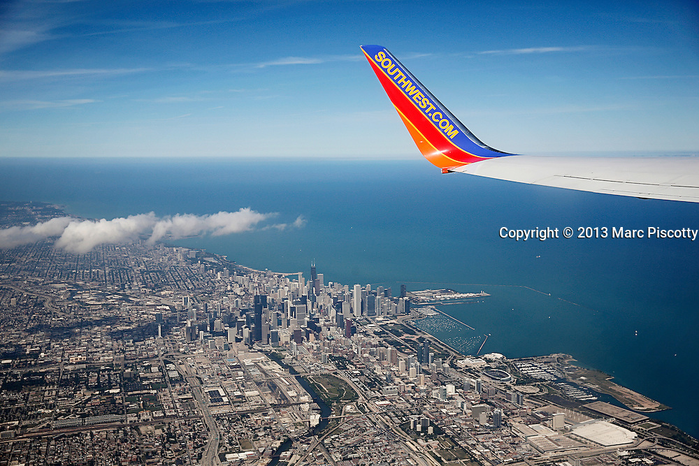 "SHOT 9/3/13 12:52:22 PM - The skyline of downtown Chicago, Ill. and Lake Michigan as seen from a Southwest Airlines flight leaving from Midway Airport. Chicago is the largest city in the US state of Illinois and the third most populous city in the United States, with around 2.7 million residents. Its metropolitan area, sometimes called ""Chicagoland,"" is the third largest in the United States, with an estimated 9.8 million people within its metropolitan area. Chicago is the county seat of Cook County. Chicago has many nicknames, which reflect the impressions and opinions about historical and contemporary Chicago. The best known include: ""Chi-town,"" ""Windy City,"" ""Second City,"" and the ""City of Big Shoulders. (Photo by Marc Piscotty / © 2013)"