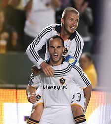 Landon Donovan and David Beckham celebrate after Donovan's goal in the first half, Los Angles Galaxy vs the San Jose Earthquakes, Thursday, April 3, 2008.