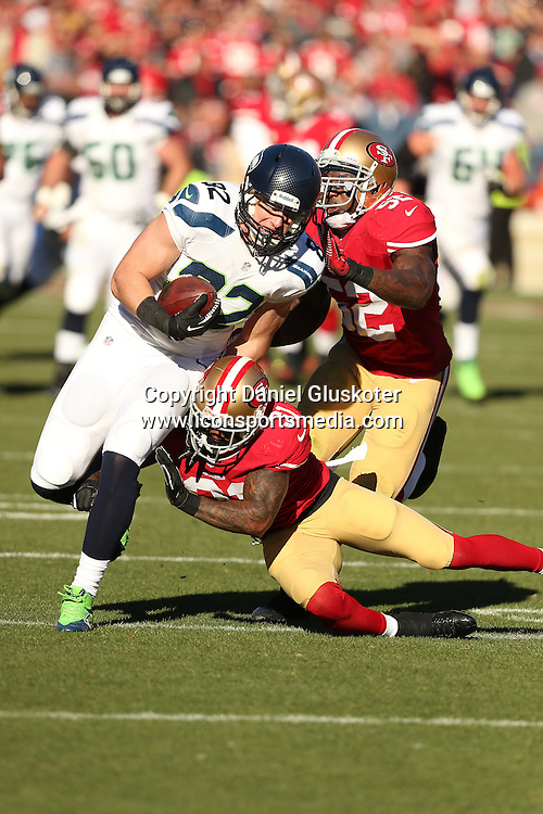 08 December 2013: Seattle Seahawks tight end Luke Wilson tries to elude Patrick Willis ( 52 ) and Donte Whitner during action in an NFL game against the Niners at Candlestick Park in San Francisco, CA. The 49ers won 19-17.