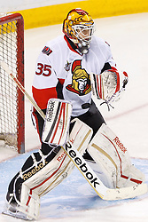 Jan 19, 2012; San Jose, CA, USA; Ottawa Senators goalie Alex Auld (35) warms up before the game against the San Jose Sharks at HP Pavilion. Ottawa defeated San Jose 4-1. Mandatory Credit: Jason O. Watson-US PRESSWIRE
