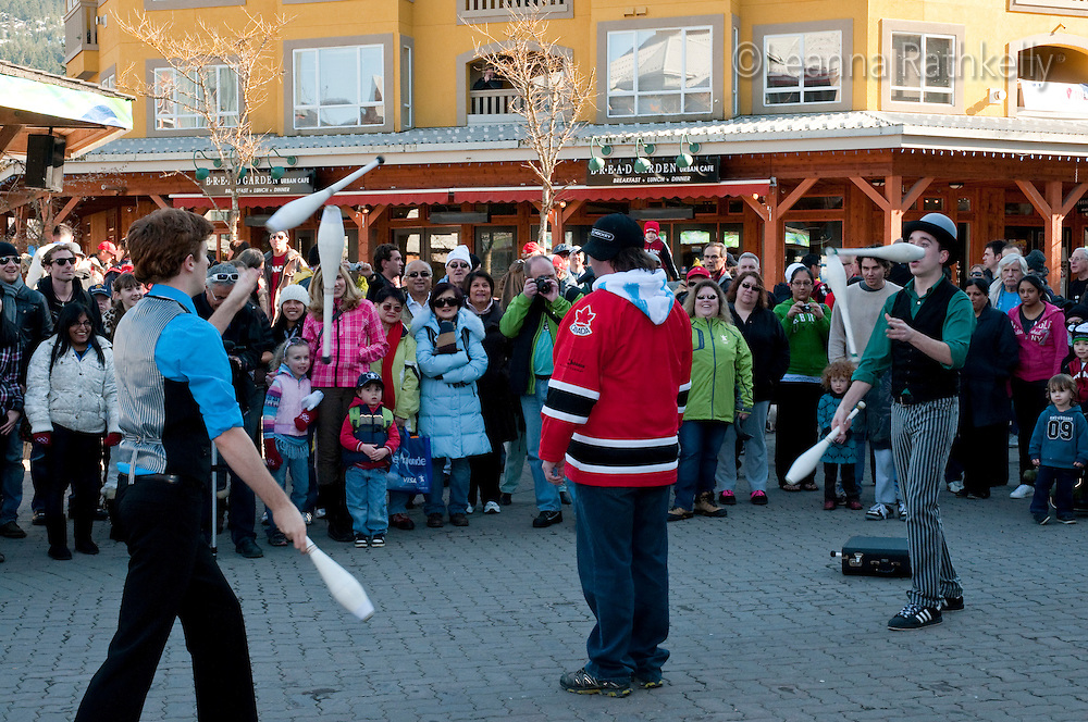 Jugglers from the troupe Wonderbolt juggle across a willing Canadian volunteer during the 2010 Olympic Winter Games in Whistler, BC Canada.
