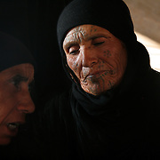 The Bedouin women many have their faces tattooed with geometric shapes. Both dress  and tattoos determine their status and marital status.