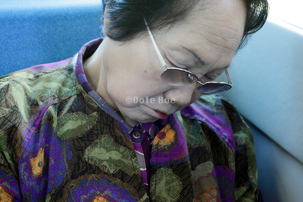 portrait of elderly Asian woman during a nap