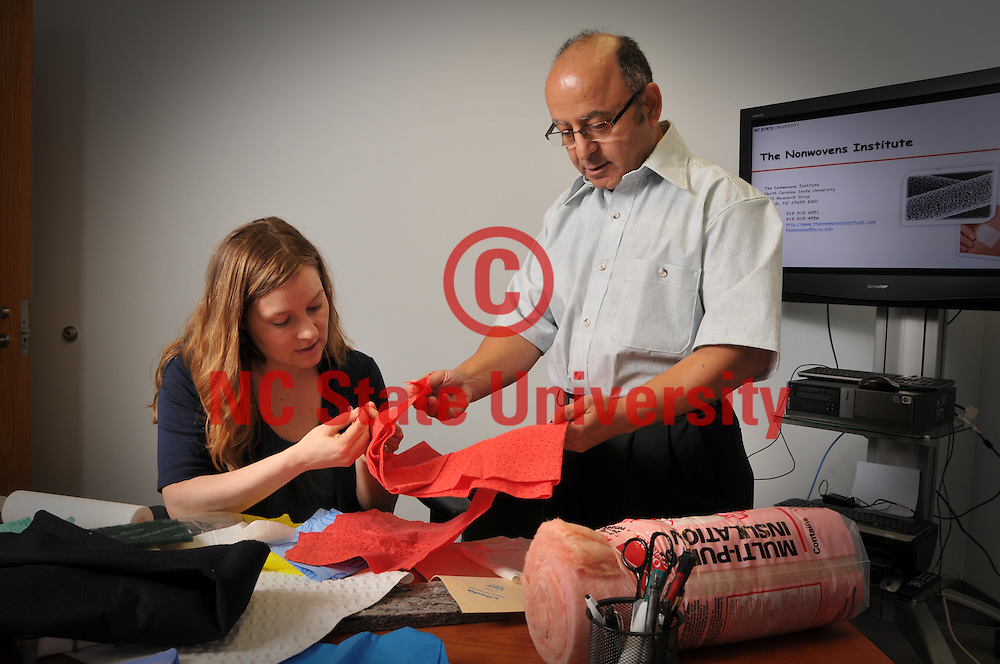 NCRC Director of Partnership and Innovation Genevieve Garland and director Dr. Benham Pourdeyhimi look over samples.