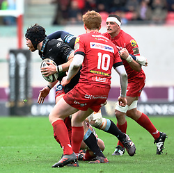 Glasgow Warriors' Tim Swinson is tackled by Scarlets' Steven Cummins<br /> <br /> Photographer Simon King/Replay Images<br /> <br /> Guinness PRO14 Round 19 - Scarlets v Glasgow Warriors - Saturday 7th April 2018 - Parc Y Scarlets - Llanelli<br /> <br /> World Copyright © Replay Images . All rights reserved. info@replayimages.co.uk - http://replayimages.co.uk