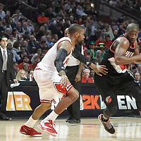 16 March 2012: Portland Trail Blazers point guard Raymond Felton (5) drives past Chicago Bulls point guard C.J. Watson (7) during the Portland Trail Blazers 100-89 victory over the Chicago Bulls at the United Center, Chicago, Illinois, USA.