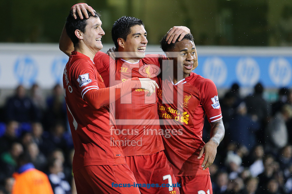 Picture by Richard Calver/Focus Images Ltd +447792 981244<br /> 15/12/2013<br /> Luis Suarez of Liverpool celebrates with team mates, Luis Alberto and Raheem Sterling after making it 4-0 during the Barclays Premier League match against Tottenham Hotspur at White Hart Lane, London.