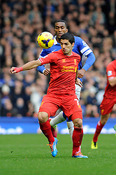 Liverpool's Luis Suarez controls the ball under pressure from Everton's Sylvain Distin - Photo mandatory by-line: Dougie Allward/JMP - Tel: Mobile: 07966 386802 23/11/2013 - SPORT - Football - Liverpool - Merseyside derby - Goodison Park - Everton v Liverpool - Barclays Premier League