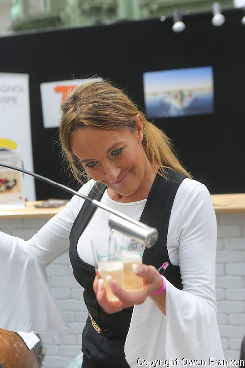 pouring Champagne at huelva stand, taste of paris