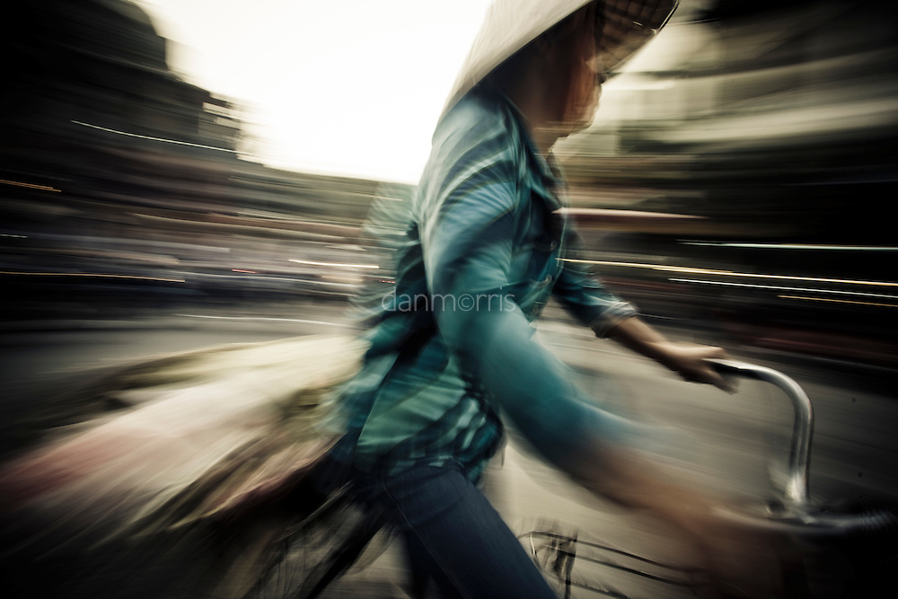 Woman biking home from market, Hanoi, Vietnam
