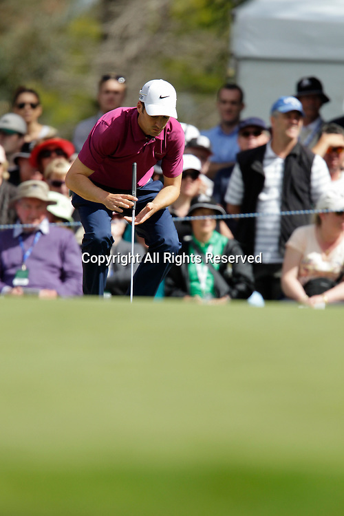 20.10.2013 Perth, Australia. Ross Fisher (ENG) lines up his putt on the 18th green with a share of the lead during the final day of the ISPS Handa Perth International Golf Championship from the Lake Karrinyup Country Club.