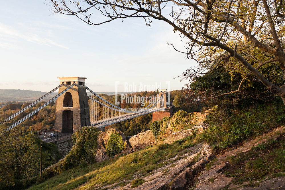&copy; Licensed to London News Pictures. 28/10/2014. Bristol, Somerset, UK. ***FILE IMAGE*** Clifton Suspension Bridge taken on 28/10/2014. The 8th December 2014 marks 150 years to the day since the bridge's grand opening on 8th December 1864. <br /> <br /> The bridge, now a Grade I listed building, was initially designed by the Portsmouth born engineer, Isambard Kingdom Brunel. He was first employed as project engineer after winning a design competition at the young age of 23 years old. Construction of the bridge started when Lady Elton, wife of major bridge investor Sir Abraham Elton of Clevedon Court, laid a small foundation stone at St Vincent&rsquo;s Rocks to mark the site of the Clifton abutment.<br /> <br /> Brunel failed to see the bridge reach completion 33 years later, as he died 5 years before its completion in 1859. Upon Brunel's death, it became the job of two distinguished civil engineers, Sir John Hawkshaw (1811 &ndash; 1891) and William Henry Barlow (1812 &ndash; 1902), to complete the bridge.<br /> <br /> The first person to cross the bridge was 21-year old Mary Griffiths from Hanham in East Bristol. Back then, the toll charge was a penny to cross. Today, cars pay &pound;1 to cross the bridge. <br /> <br />  ***FILE IMAGE*** Photo credit : Rob Arnold/LNP