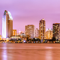 Panorama picture of San Diego skyline at night with purple tone. Panoramic photo ratio is 1:3. San Diego is a major city in Southern California in the United States.