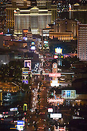 Beautiful downtown Las Vegas, NV, Sin City, glows at night, viewed from the top of the Stratosphere Tower. The famous 'strip' of Casinos is seen, with Caesars Palace dominating the top of the frame.