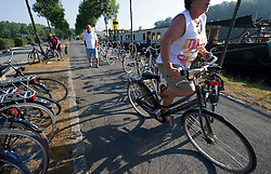 Tourists from Germany enjoy a Boat and Bike tour through Flanders. A tour member tests her bike before leaving for the morning ride from Bruges to Damme, in the Flemish region of Belgium, on Sunday, July 11, 2010. (Photo © Jock Fistick)