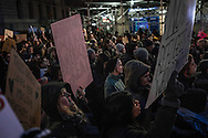 Protesters march down a street at an Anti-Trump rally in Lower Manhattan, after the Trump administration implemented a ban on entry to citizens of 7 Muslim-majority nations into the United States.  New York, New York, USA.  29 January 2017