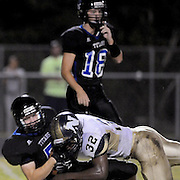 Trask High School's Dylan Kraft, background looks on as Michael Stroman is tackled behind the line of scrimmage by North Brunswick's Evin Bellamy Friday August 29, 2014. (Jason A. Frizzelle)