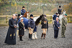 HMS Drake chaplain Reverend Mike Pons (left) delivers a reading during the first ever memorial service dedicated to horses killed or injured in conflict, at the Royal Navy and Royal Marines Riding Stables at Bickleigh Barracks, Plymouth.