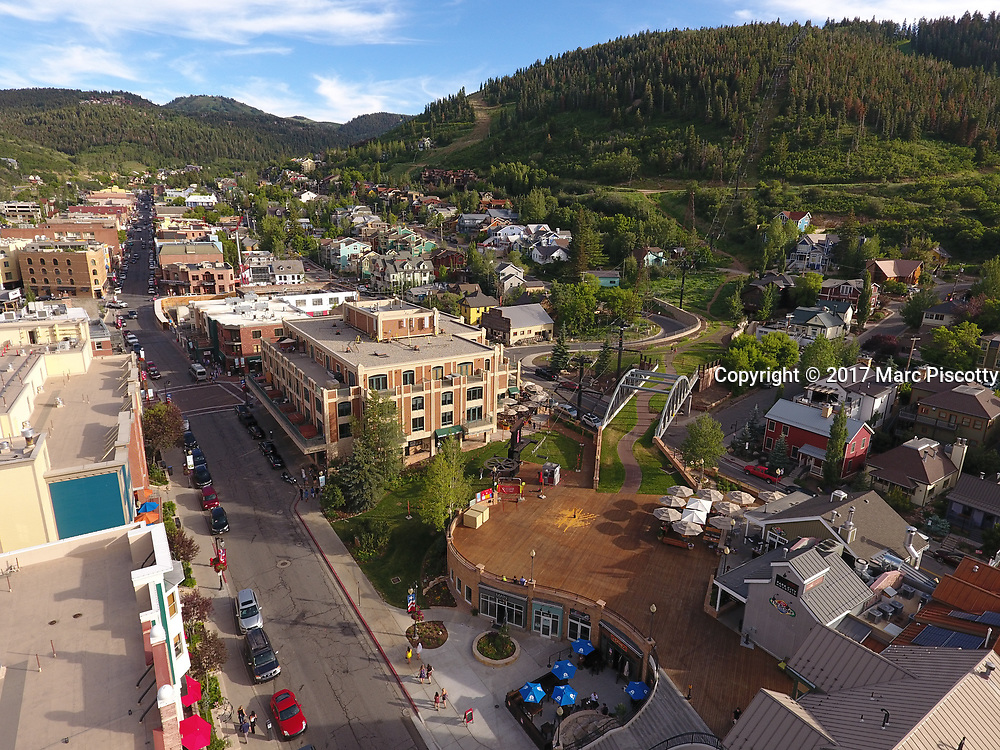 SHOT 7/1/17 6:54:52 PM - Drone photos of Park City, Utah. Park City lies east of Salt Lake City in the western state of Utah. Framed by the craggy Wasatch Range, it's bordered by the Deer Valley Resort and the huge Park City Mountain Resort, both known for their ski slopes. Utah Olympic Park, to the north, hosted the 2002 Winter Olympics and is now predominantly a training facility. In town, Main Street is lined with buildings built during a 19th-century silver mining boom. (Photo by Marc Piscotty / © 2017)