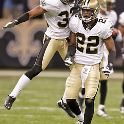 2009 October 18: New Orleans Saints cornerback Tracy Porter (22) and cornerback Jabari Greer (32) celebrates on the field during a 48-27 win by the New Orleans Saints over the New York Giants at the Louisiana Superdome in New Orleans, Louisiana.