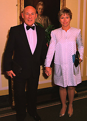 Veteran racing driver STIRLING MOSS & MRS MOSS at a ball in London on 12th February 1998.MFL 3