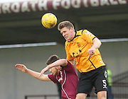 Annan's Peter Watson head clear from Arbroath's Greg Rutherford - Arbroath v Annan Athletic, Ladbrokes SPFL League two at Gayfield<br /> <br />  - &copy; David Young - www.davidyoungphoto.co.uk - email: davidyoungphoto@gmail.com