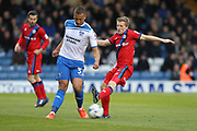 Jamie Allen challenges Reece Brown during the EFL Sky Bet League 1 match between Bury and Rochdale at the JD Stadium, Bury, England on 13 April 2017. Photo by Daniel Youngs.
