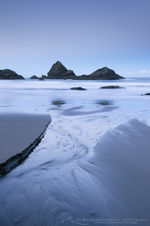 Creek flowing into Pacific Ocean at twilight, Harris Beach State Park, Oregon