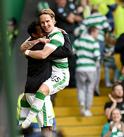 15/07/15 UEFA CHAMPIONS LEAGUE QUALIFIER<br /> CELTIC V STJARNAN<br /> CELTIC PARK - GLASGOW<br /> Celtic's Stefan Johansen (right) celebrates his goal with substitute Efe Ambros.