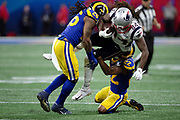 New England Patriots wide receiver Cordarrelle Patterson (84) gets gang tackled by Los Angeles Rams inside linebacker Mark Barron (26) and Rams cornerback Marcus Peters (22) as he catches a late second quarter pass for a gain of 5 yards to the Rams 46 yard line during the NFL Super Bowl 53 football game on Sunday, Feb. 3, 2019, in Atlanta. The Patriots defeated the Rams 13-3. (©Paul Anthony Spinelli)