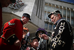 © Licensed to London News Pictures. 27/09/2015. London, UK. A Pearly King (R) talks to a Chelsea Pensioner in Guildhall Square during a Harvest Festival celebration. Photo credit: Peter Macdiarmid/LNP