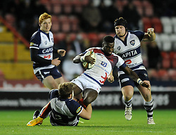 London Scottish winger, Matt Williams is tackled by Bristol Rugby hooker, Rhys Lawrence - Photo mandatory by-line: Dougie Allward/JMP - Mobile: 07966 386802 - 05/12/2014 - SPORT - Rugby - Bristol - Ashton Gate - Bristol Rugby v London Scottish - B&I Cup