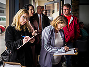 04 APRIL 2019 - CARROLL, IOWA:  People sign in at a Beto O'Rourke meet and greet. Beto O'Rourke stopped at Kerps Tavern in Carroll, IA, to campaign for president Thursday. He is crisscrossing Iowa through the weekend with stops throughout the state. Iowa holds its caucuses, considered the kickoff of the US Presidential campaign, on Feb. 3, 2020.    PHOTO BY JACK KURTZ